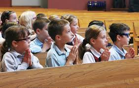 students in prayer