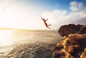 person-diving-into-lake